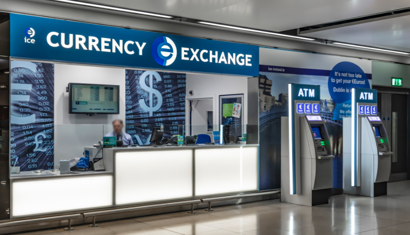 currency exchange unit with worker dublin airport